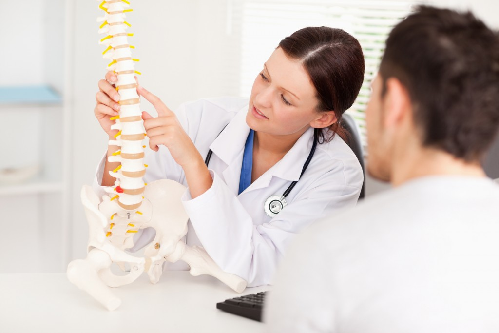 female-doctor-pointing-at-spinal-cord