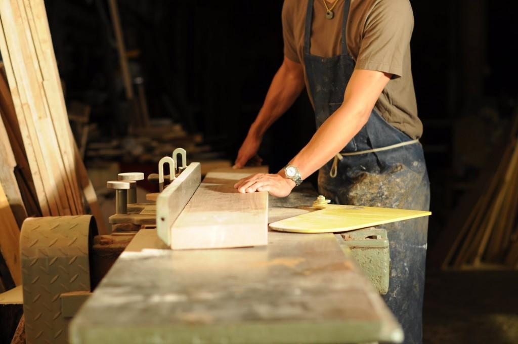 man-using-saw