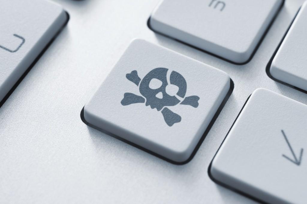 software-piracy-keyboard-skull-music-pirate-cyber-crime